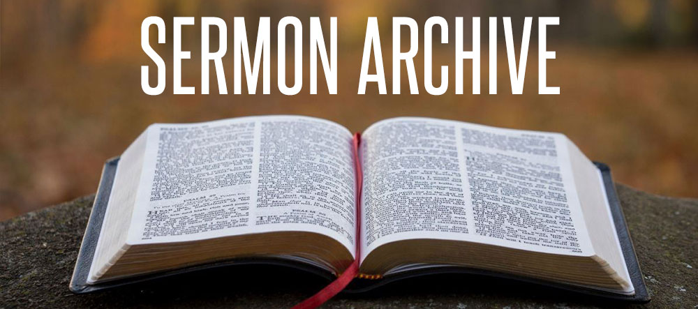 Bible opened with SERMON ARCHIVE text across the top
