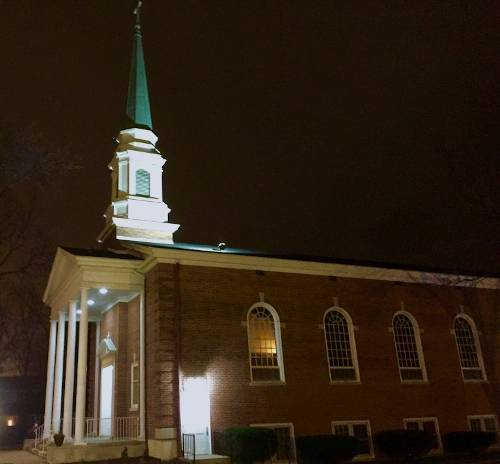 Outside photo shot of the Souls Harbor Baptist Church building at night