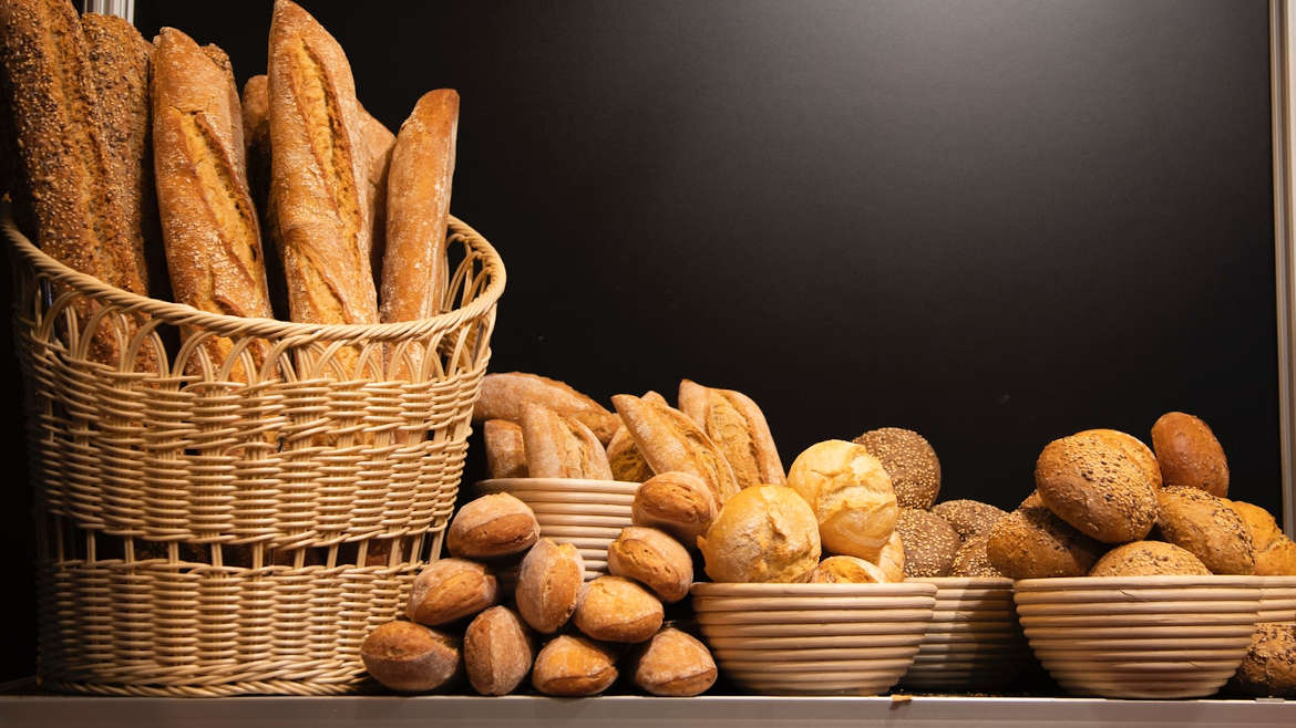 Assortment of bread loves in baskets and bowls