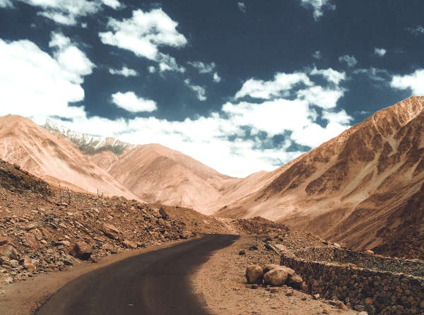 Winding road in the desert among mountains